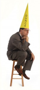 Man wearing a dunce cap