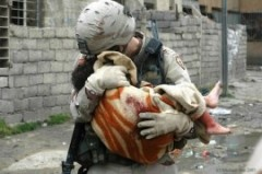 Soldier carrying child